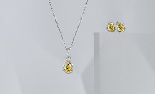 Pear Shape Fancy Yellow Diamond Pendant and Earrings