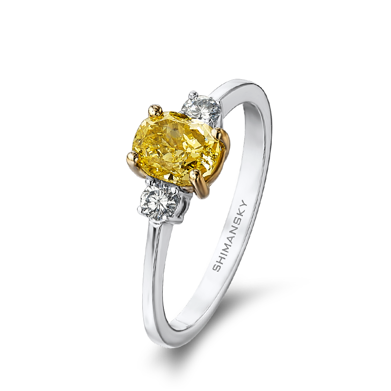 02-claw-set-oval-cut-fancy-yellow-diamond-ring-set-with-round-brilliant-cut-diamonds-01