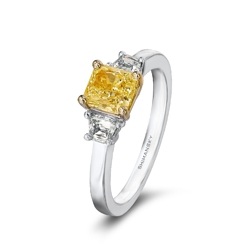 28-claw-set-cushion-cut-yellow-diamond-trilogy-ring-set-with-criss-trapese-cut-diamonds-01